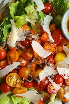 NYT Cooking: Whether the tomatoes deserve it or not, I make some version of a tomato Caesar salad every summer. Here, I inverted the usual proportions of lettuce to tomatoes, favoring the tomatoes. It was the juiciest of Caesars, and pretty, too, dotted with anchovies and curls of Parmesan.