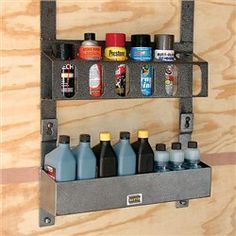 RACK 'EM Manufacturing Lubrication Rack  Bin  Not only does it hold spray cans, it now has a second level to hold quarts of oil!