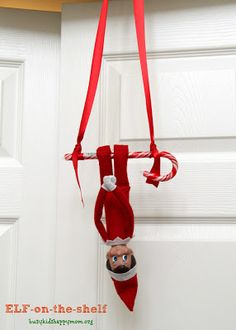 Elf on a shelf idea - Hanging upside down on a candy cane swing