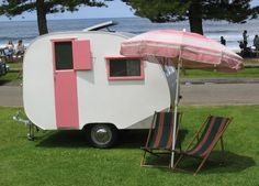 From the blog, Oldfashionedpretty this adorable pink and white trailer (caravan in Europe)