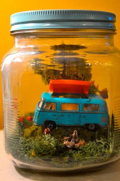 Miniature Spring VW Bus scene with deer, tree, red flowers, campfire, and LED lights in glass jar with painted yellow lid