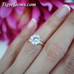 🌺 Newly listed at www.TigerGems.com! 🌺 2 carat, two-toned 14k yellow and white gold solitaire ring. Video soon! 💍💐