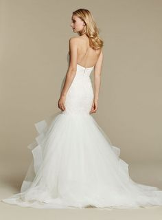 """""""Azi"""" gown. Ivory lace fit to flare bridal gown, strapless sweetheart elongated bodice, tiered tulle skirt with horsehair trim."""