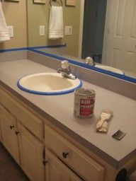 Painting laminate counter tops to make them look like stone without the high price tag! I might need this""