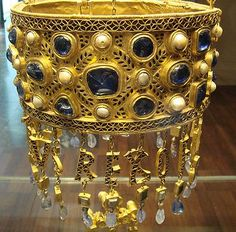 A votive crown belonging to Recceswinth (653–672), as found in the treasure of Guarrazar, Spain. (National Archaeological Museum of Spain).