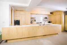 Made to measure kitchen in Spruce plywood By Fermetti Photography Maarten Stappaerts