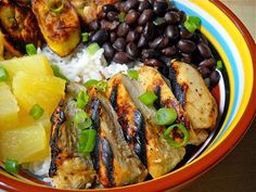 It's a complete meal in a bowl with jerk chicken, coconut rice, black beans, and pineapple. Step by step photos.