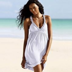 White Sundress Sundress ideal for the beach. The straps have a ruffle detailing. Size S,M Dresses Mini