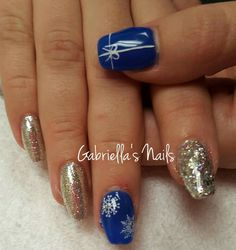 Acrylic present snowflake nail art blue and silver glitter nails