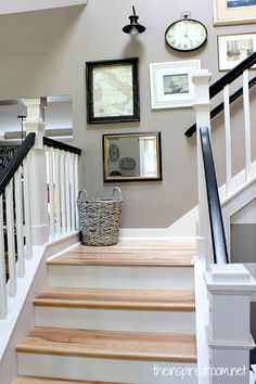 Entry Staircase Makeover with Before and Afters! Black and white railings, Hickory wood steps and floors {from Lowe's}.#stairs #staircase #makeovers