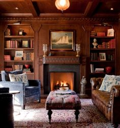 Gorgeous & warm, with carved walls in this living room/den, great built-in lighted book shelves, antique looking brown leather curled arm sofa, antique oriental rug, and panel and beamed ceiling. Very lovely, relaxing room.