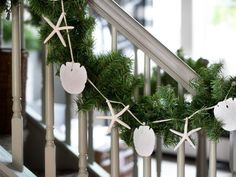 Turn Beach Treasures Into a Garland - Our 65 Favorite Handmade Holiday Decorating Ideas on HGTV Coastal Christmas Decor, Nautical Christmas, Diy Christmas Decorations Easy, Diy Christmas Ornaments, Coastal Decor, Handmade Christmas, Christmas Wreaths, Handmade Ornaments, Purple Christmas