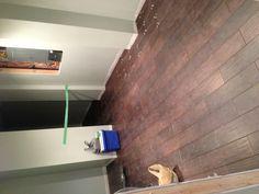 Hardwood style tile  Dark hardwood tile tiles basement recreation room