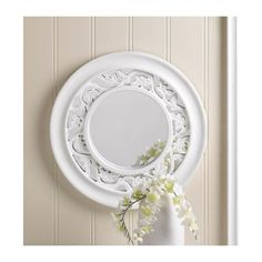 """WHITE IVY WALL MIRROR Make your space appear larger and more stylish with this striking wall mirror. The white round wooden frame features a cutout leaf pattern that lets the mirror peek through from behind. This is the perfect finishing touch for over your mantel or hall table. Saw tooth on back for hanging. Reflective mirror: 6 1/4"""" diameter.  Materials: WOOD - MDF MIRROR"""