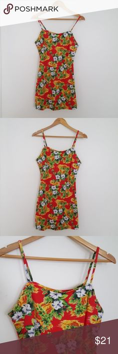 """Vintage Hawaiian Floral Mini Slip Dress Vintage slip Hawaiian mini dress with spaghetti straps. Pattern is most floral with either a waterfall or lava motif. Polyester and spandex blend fabric has a flattering stretch and has a slight flair after it hits the waist. Marked size large, but closer to a modern small/medium. 33"""" long, 15.5"""" across the waist, and 17.5"""" across the bust. See last pic for small imperfection on the back of the dress. Dresses"""