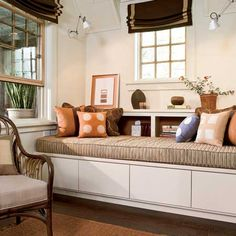 I want this kind of window seat (storage space beneath, cushion on top) but for it to wrap around the corner.
