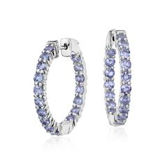 Blue Nile Tanzanite Hoop Earrings in Sterling Silver (3mm) Finish your look with these hoop earrings featuring tanzanite gemstones crafted in a settings of sterling silver.