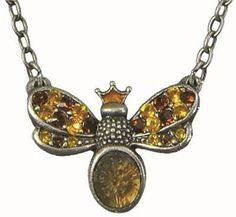 Queen Bea Pendant Necklace made with lead free pewter, swarovski crystals, enamel, and etched glass. $59.00