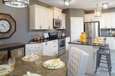 Dining room and kitchen in the Orion II showhome in King's Heights in Airdrie, by Shane Homes. New Homes, Dining Room, House Design, Kitchen, Home Decor, Cooking, Decoration Home, Room Decor, Dining Room Sets