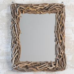 Rectangular Driftwood Mirror A natural driftwood frame creates an earthy textural statement suitable for coastal baths or rustic mountain entryways. Natural variations in the colors and hues of the driftwood are to be enjoyed.