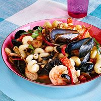 Mixed Seafood Pasta Puttanesca ~ recipe ~ uses cavatappi pasta, shrimp & mussels ~ rachaelraymag