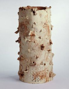 add to bits and pieces of clay on the outside to create some real interest. This is by miguel barcelo