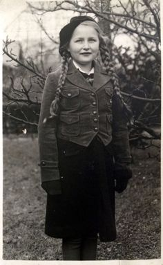 """A young German girl, a member of the Bund Deutscher Mädel (""""League of German Girls""""), with a Hitler Youth pin on her front jacket pocket, via Jedem das seine. The BDM was the only female youth organization in Nazi Germany, and the female branch of the overall Nazi Party youth movement, the Hitler Youth."""