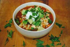 Vegetarian chili topped with cheddar cheese and avocado
