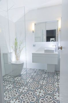 tile flooring for bathrooms this beautiful white bathroom design has combined a modern white vanity unit and toilet with a more traditionally inspired pattern tiled floor marble tile bathroom floor id Patterned Bathroom Tiles, Small Bathroom, Shower Room, Bathroom Tile Designs, Bathroom Inspiration, Bathroom Decor, Amazing Bathrooms, Bathroom Design Small, Bathroom Renovations