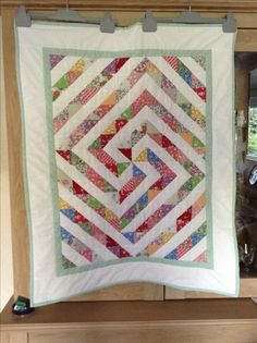 Half Square Triangle Quilt. Colorful quilt. Love the quilt pattern this produces. Peace, Robert from nancysfabrics.com