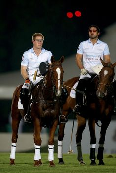 L-R) Prince Harry and Saeed Bin Drai during the Sentebale Polo Cup presented by Royal Salute World Polo at Ghantoot Polo Club on November 20, 2014 in Abu Dhabi, United Arab Emirates.