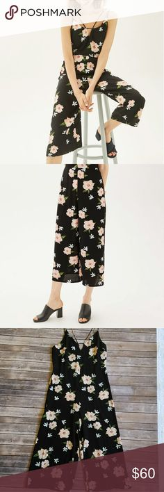 """Topshop floral jumpsuit Double strapped floral jumpsuit. Wide legged. Inseam is 22"""" waist is 16.5"""" and bust is 18.5"""". Brand new with tags and in excellent condition. Topshop Pants Jumpsuits & Rompers"""