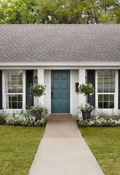Episode Season 5 The exterior needed one final thing, and I love a bold door, so we brought the blue color from inside the house out to the front door. This modern twist provided a great focal point for the exterior and gave it personality. White Brick Houses, White Exterior Houses, House Paint Exterior, Exterior House Colors, Exterior Design, Ranch Exterior, White House Exteriors, Beige House Exterior, Brick Ranch Houses