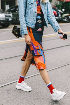 Street Style_light coloured denim jacket layered over printed tube dress worn back with white sneakers and coloured socks || Saved by Gabby Fincham ||