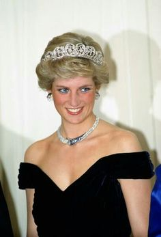 """The Princess of Wales attends a state banquet in Bonn in November 1987. She wears a spectacular Victor Edelstein deep blue silk-velvet dinner dress with off-the-shoulder straps and a slight bustle. The dress has a draped effect and a large velvet bow adorning the back. The Princess also wears, for the first time in public, the matching set of jewels presented to her by the Sultan of Oman in 1986. The Spencer family tiara adds an extra touch of sophistication."" - DuchessOrange at…"