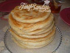 Malzemeler 1 çorba kaşığı sıvıyağ 5 su bardağı un Su Tuz 1 tatlı kaşığı kuru maya  İçi İçin yarım paket margarin 3 çorba kaşığı tahin