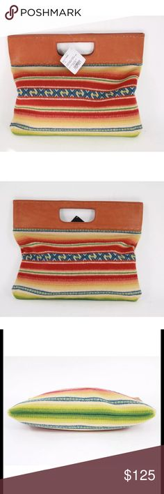 "Pendleton Casa Grande Stripe Oversized Clutch Condition:  New with tags, small dent in leather on handle (not noticeable- see pics)  Details:  Per the Pendleton website: Can be used folded in half as a clutch or carried with top handle. Cotton twill lined with one interior zip pocket. Random horizontal pattern placement.   16"" x 9""   82% wool/18% cotton   Leather handle and lacing detail   Spot Clean   Imported of USA fabric Pendleton Bags Clutches & Wristlets"