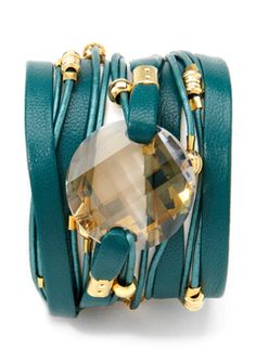 Beautiful leather wrap bracelet! We have DEF got the big crystal and I think the deerskinlacing and greek leather with silver findings...me likey!