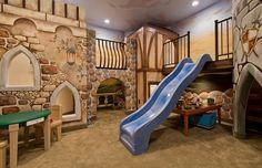 Basement playroom with a slide entry design