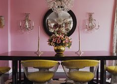 pretty dining room with pink and yellow decor accents