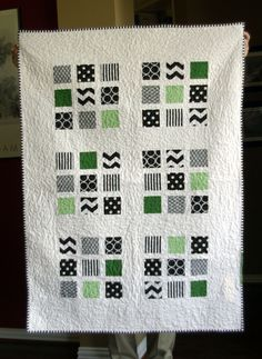 Modified 9-Patch in Black/White/Green with white sashing and border ...looks like the squares are floating!