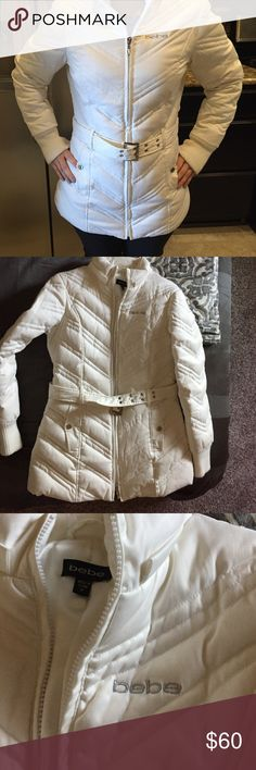 Bebe white puffer jacket coat! Selling my favorite Bebe white jacket used when I went to Colorado! I don't go much anymore so have not worn it in a while given the Texas heat! On the sleeves since they are sweater material a little wear but can be dry cleaned I am sure. The wear is not noticeable as you can see in the picture just a little dirty. bebe Jackets & Coats Puffers