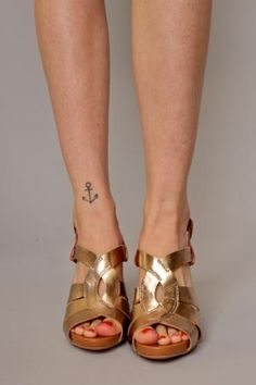 That tattoo is pretty much the exact one I  want to get!  But on the back of my leg/ankle, not front :)