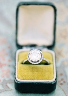 gorgeous vintage halo wedding ring.