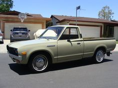 """1974 Datsun 620 Pickup, Mine was a 1969.  Looked very much like this one though.  I built a wooden canopy and Kathy and I drove this as our """"honeymoon vehicle"""" to Fort Riley Kansas where I was stationed during Viet Nam."""