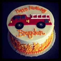 Fire Truck birthday cake with buttercream flames by Sweeten Up Bake Shop. Austin, Cedar Park, Round Rock, Texas. www.sweetenupbakeshop.com