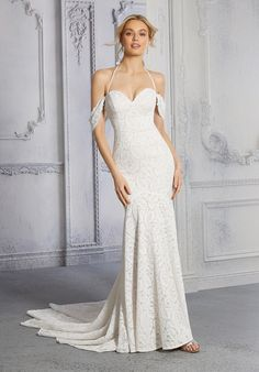 The soft mermaid wedding dress, in leaf-patterned stretch lace, features a sweetheart bodice with halter straps and detachable, off-the-shoulder sleeves. Mermaid Dresses, Girls Dresses, Formal Dresses, Net Gowns, Honeymoon Style, Fit And Flare Wedding Dress, Ball Gown Dresses, Bridal Wedding Dresses, Bridal Collection