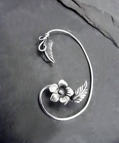 Welcome! We appreciate your interest in our jewelry. Please click on the Shipping & Policies tab below to see our current shipping schedule. Thanks. . A sweet Summer bouquet encircles your ear, in full leaf and flower in this sterling silver ear cuff wrap. A handforged sterling wire