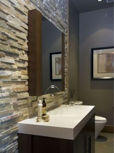 Front bathroom -- stacked stone wall and funky sink....Neutrals with high contrast!