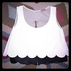 Super trendy black n white faux leather top  Such a perfect, fun top! Has a zipper in back with peekaboo opening in back as well. Semi-crop top. Love love this one, only selling because it no longer fits! Perfect with fun multicolored shorts (check out the Cynthia Rowley ones I have listed:) or black skinny jeans. ❤️❤️ Caitlin Michelle Tops Blouses